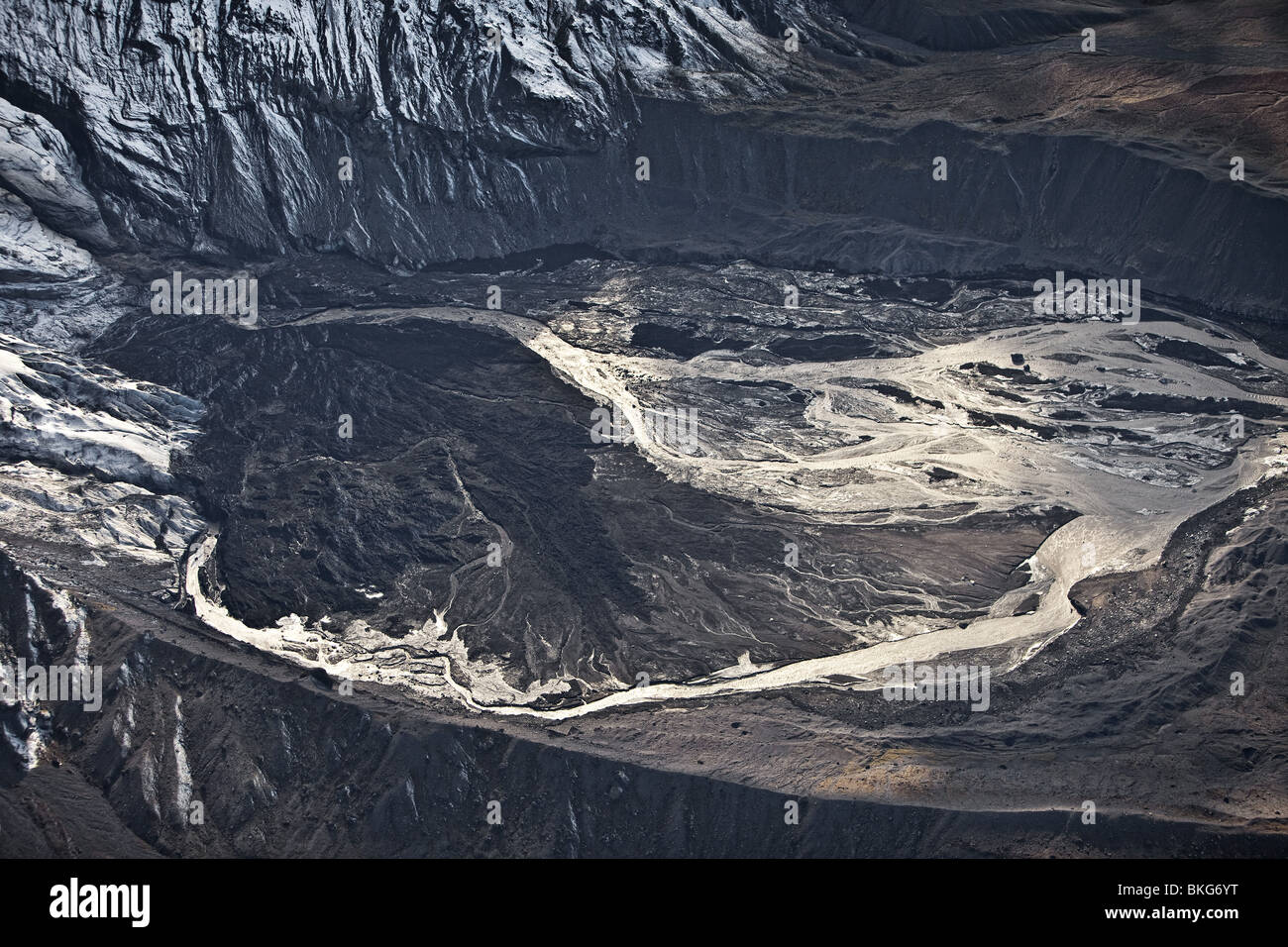 Gigjokull,-outlet glacier from Eyjafjallajokull.  Lagoon filled with mud and ash, Eyjafjallajokull Volcano Eruption, - Stock Image