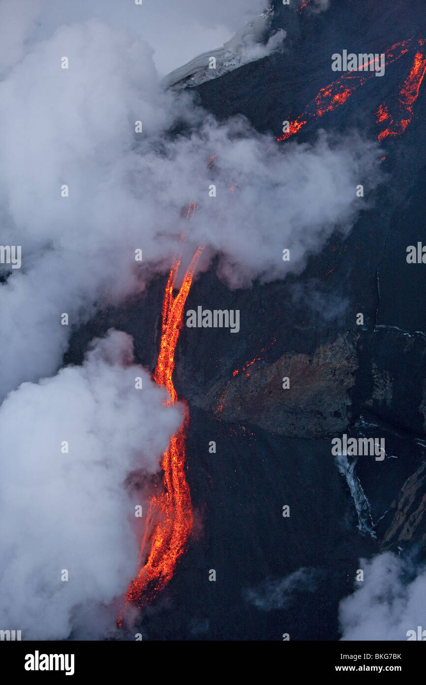 Fire and Ice-volcano eruption in Iceland at Fimmvorduhals, a ridge between Eyjafjallajokull glacier and Myrdalsjokull - Stock Image