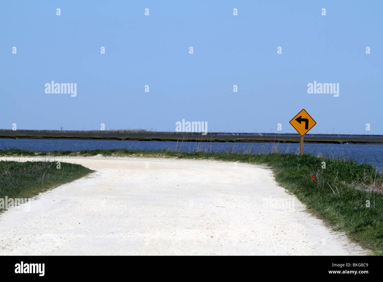 Unpaved road bending left - Stock Image