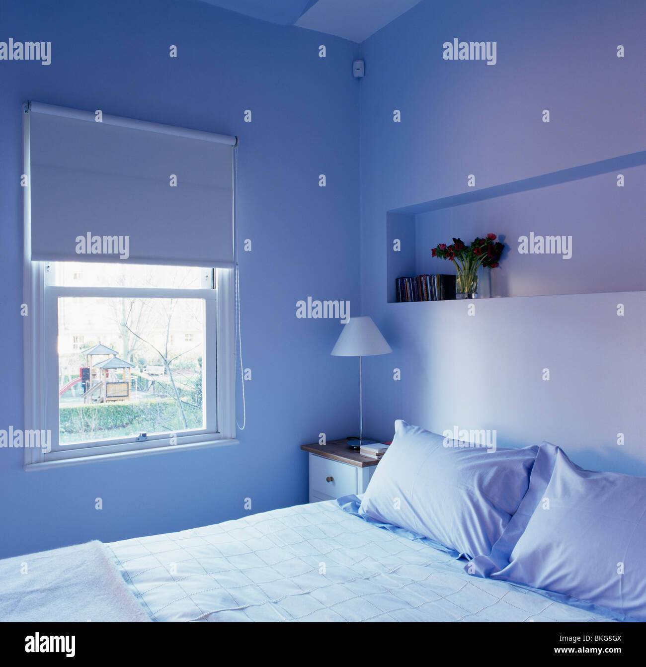 Blue blind on window in modern blue apartment bedroom with alcove ...