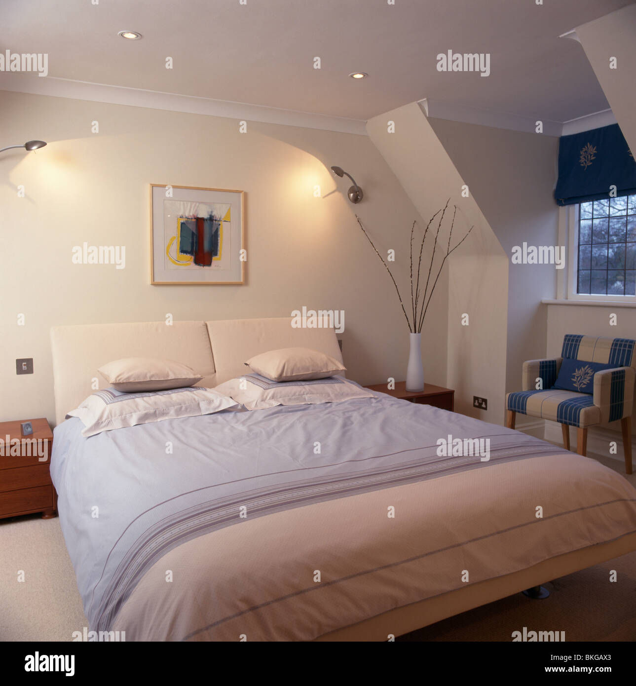 Metal Wall Lights Above Bed With Pastel Pink And Blue Bedlinen In Modern Attic Bedroom