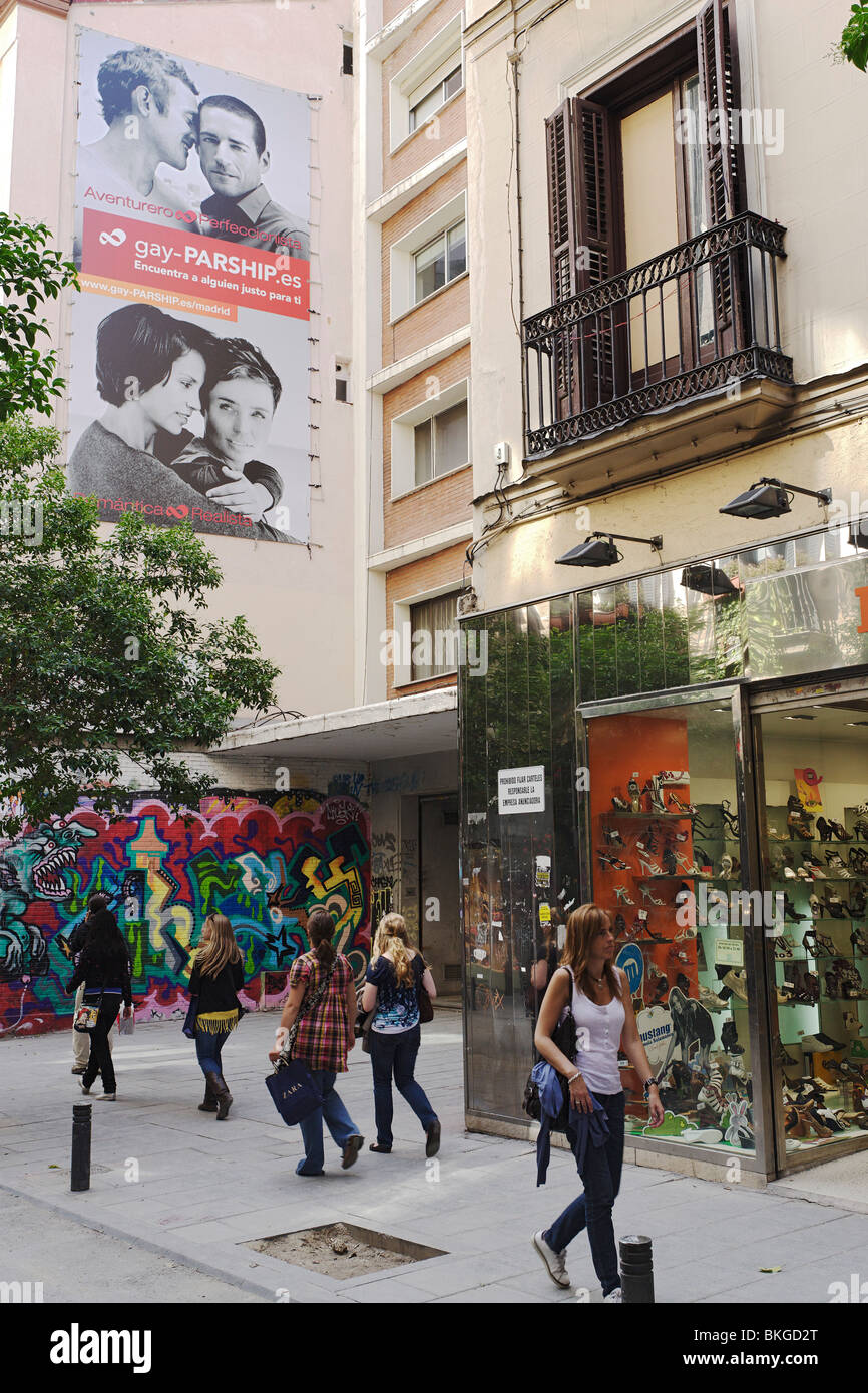 Gay advertising on house wall, Chueca, Madrid, Spain - Stock Image