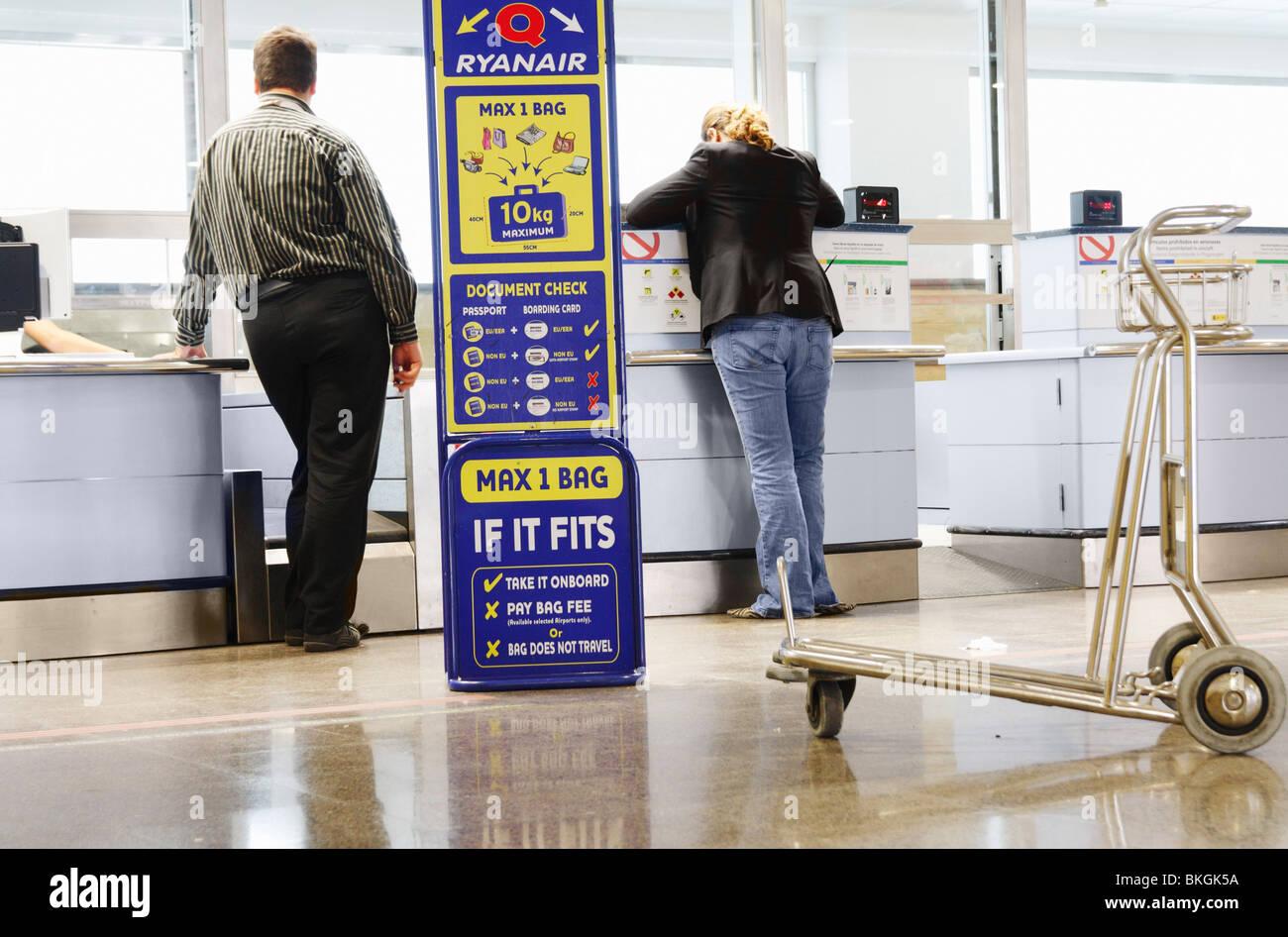 Ryanir check-in at airport terminal - Stock Image