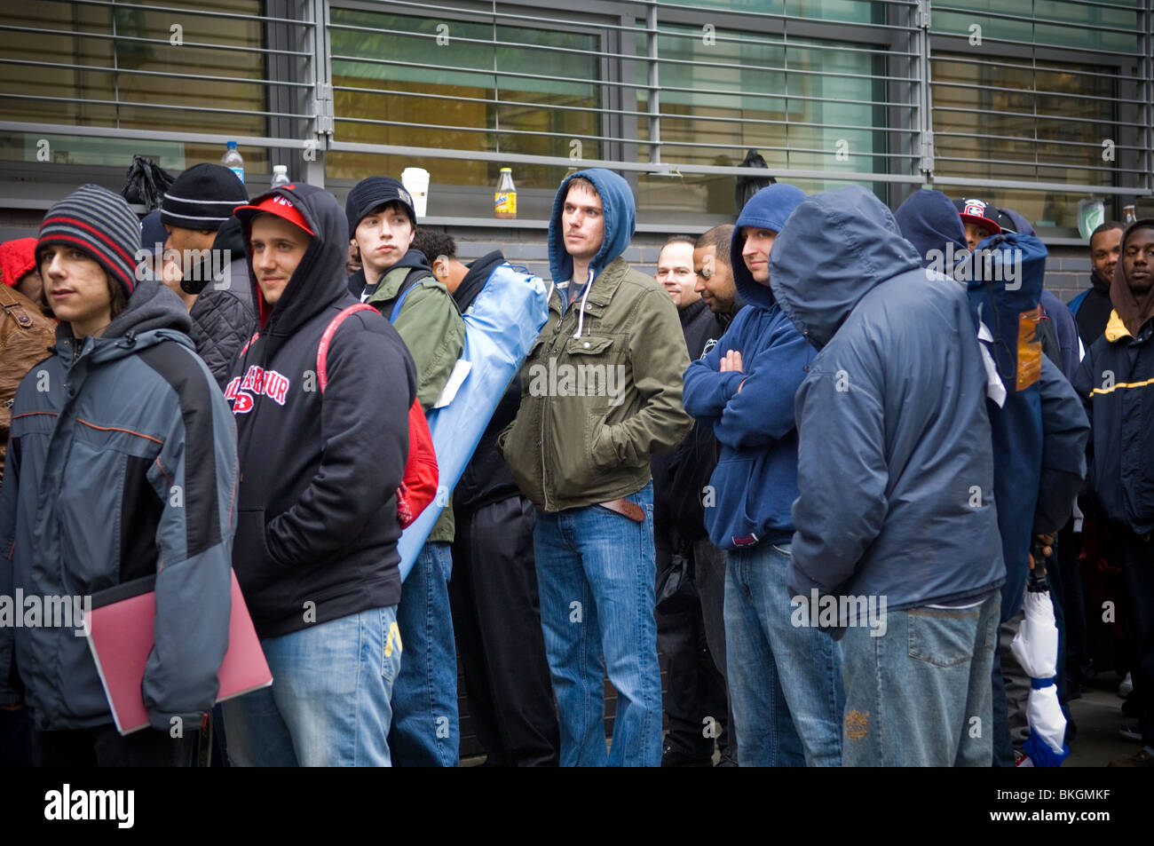 Job seekers wait on line for applications for the