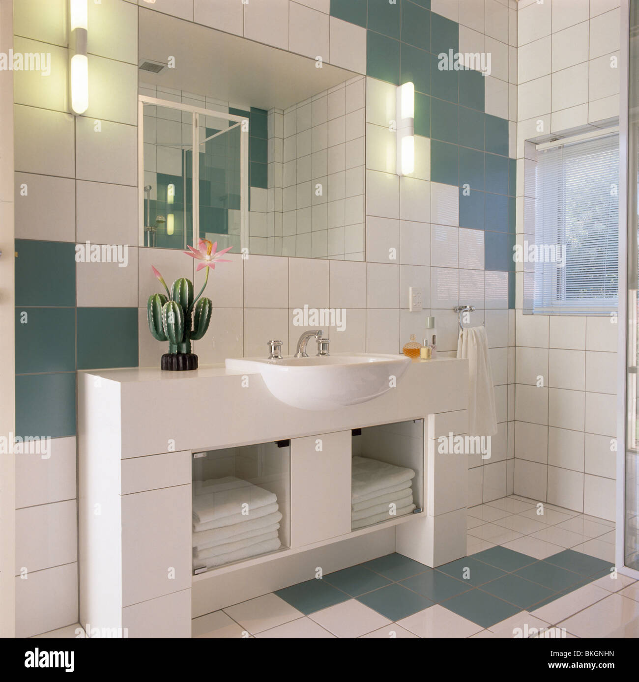 Mirror above basin in vanity unit with storage shelves in modern ...