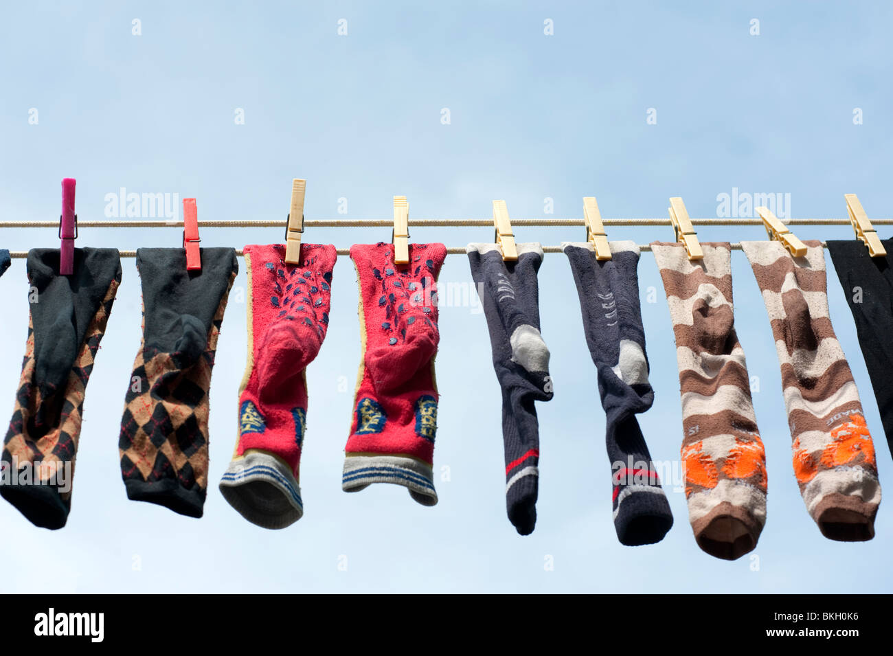 Row of socks drying on washing line in Burano Italy - Stock Image