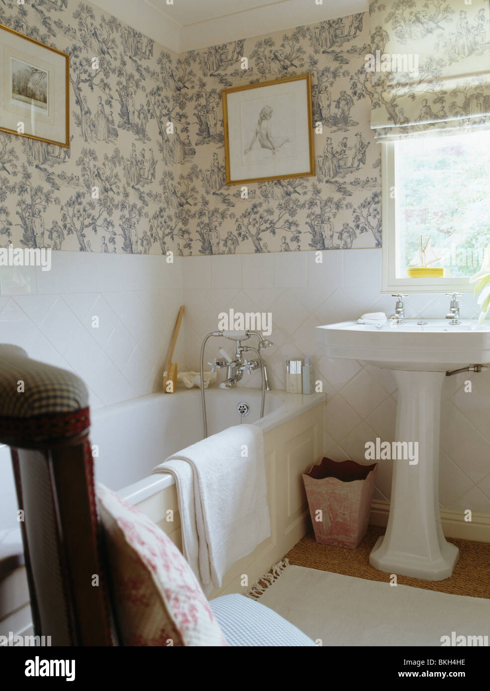 . Blue white wallpaper in small country bathroom with white pedestal