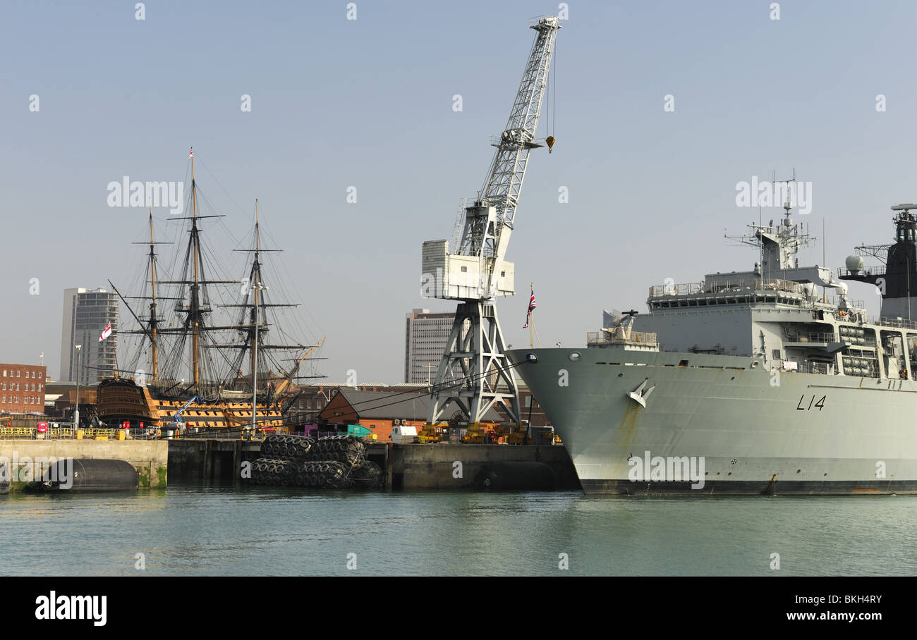 The Royal Naval Dockyard, Portsmouth, with HMS Albion L14 foreground and HMS Victory in background. - Stock Image