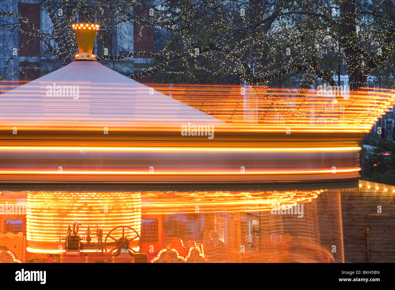 A fairground ride outside the Natural History Museum in London, UK. - Stock Image