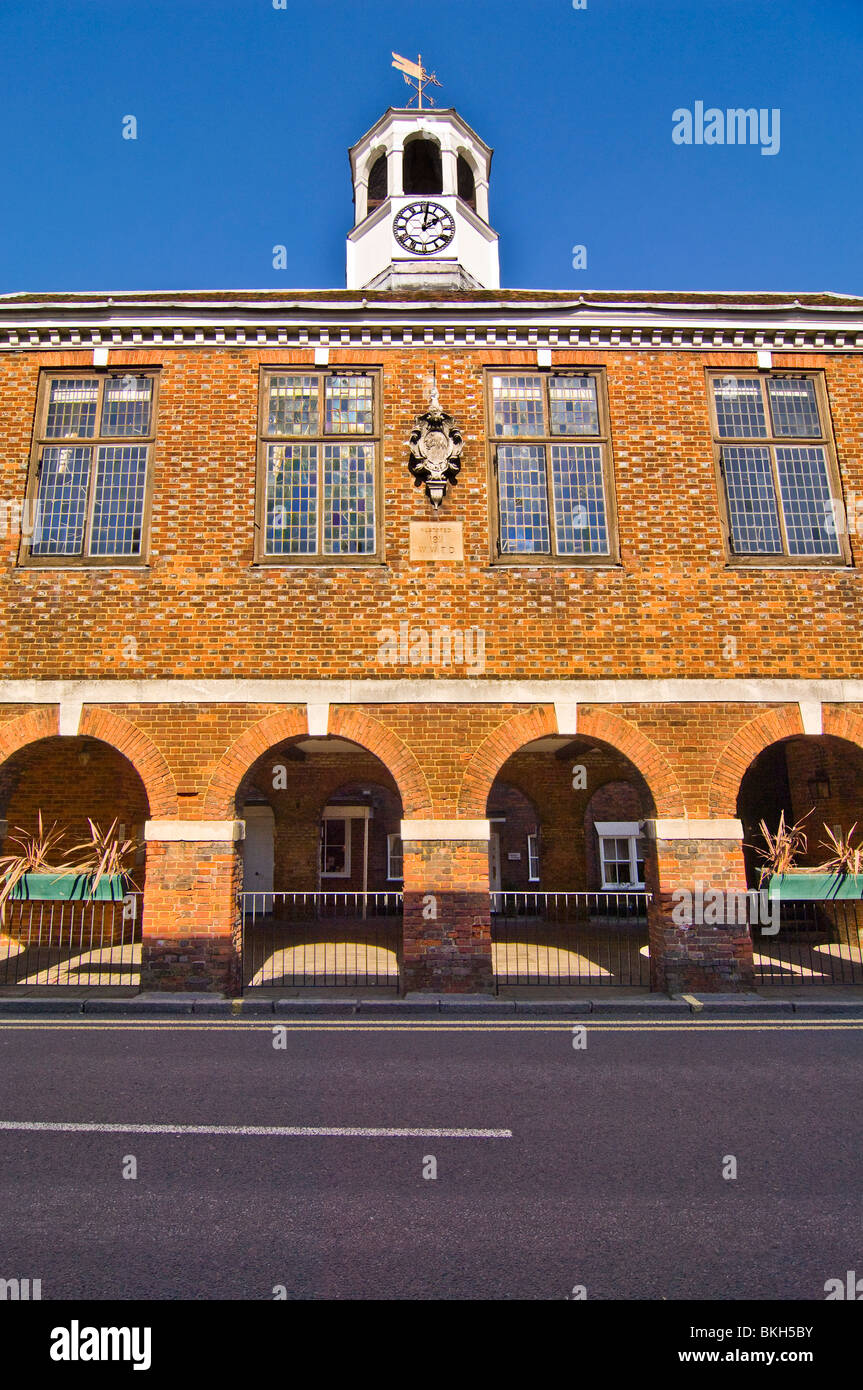 Vertical wide angle view of the prominent red brick Market Hall in Old Amersham High Street on a sunny day. Stock Photo