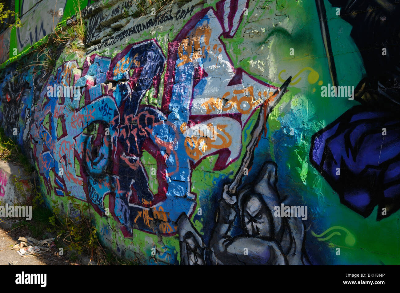 Bulging cracked wall full of tags and graffiti art at Keele subway station Toronto - Stock Image