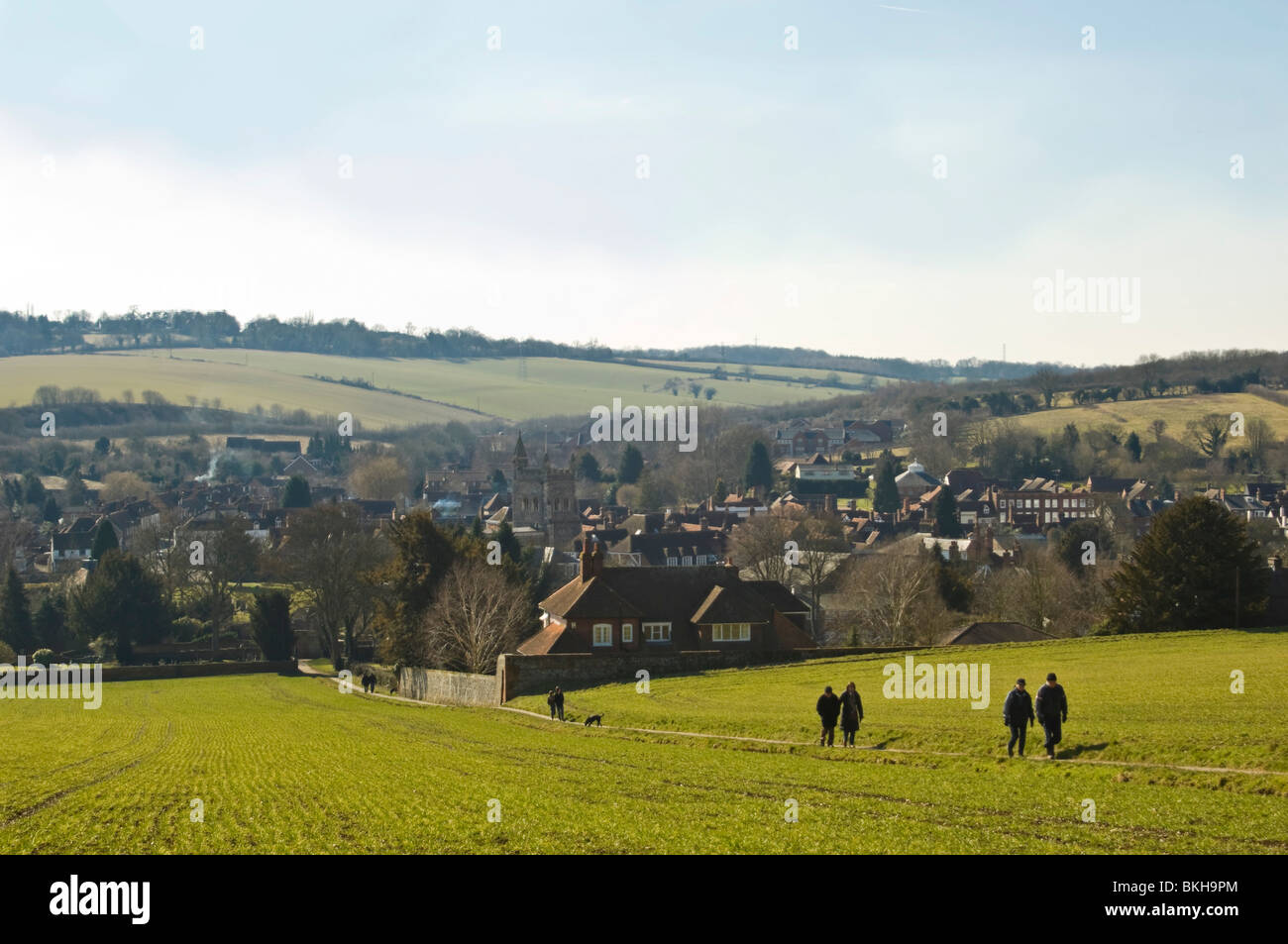 Horizontal wide angle view across the Chiltern Hills of Old Amersham with people walking up the hill on a sunny Stock Photo