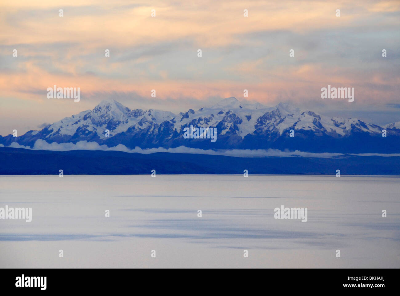 View of snow capped mountains as seen from Isla del Sol, Lake Titicaca, Bolivia, South America - Stock Image