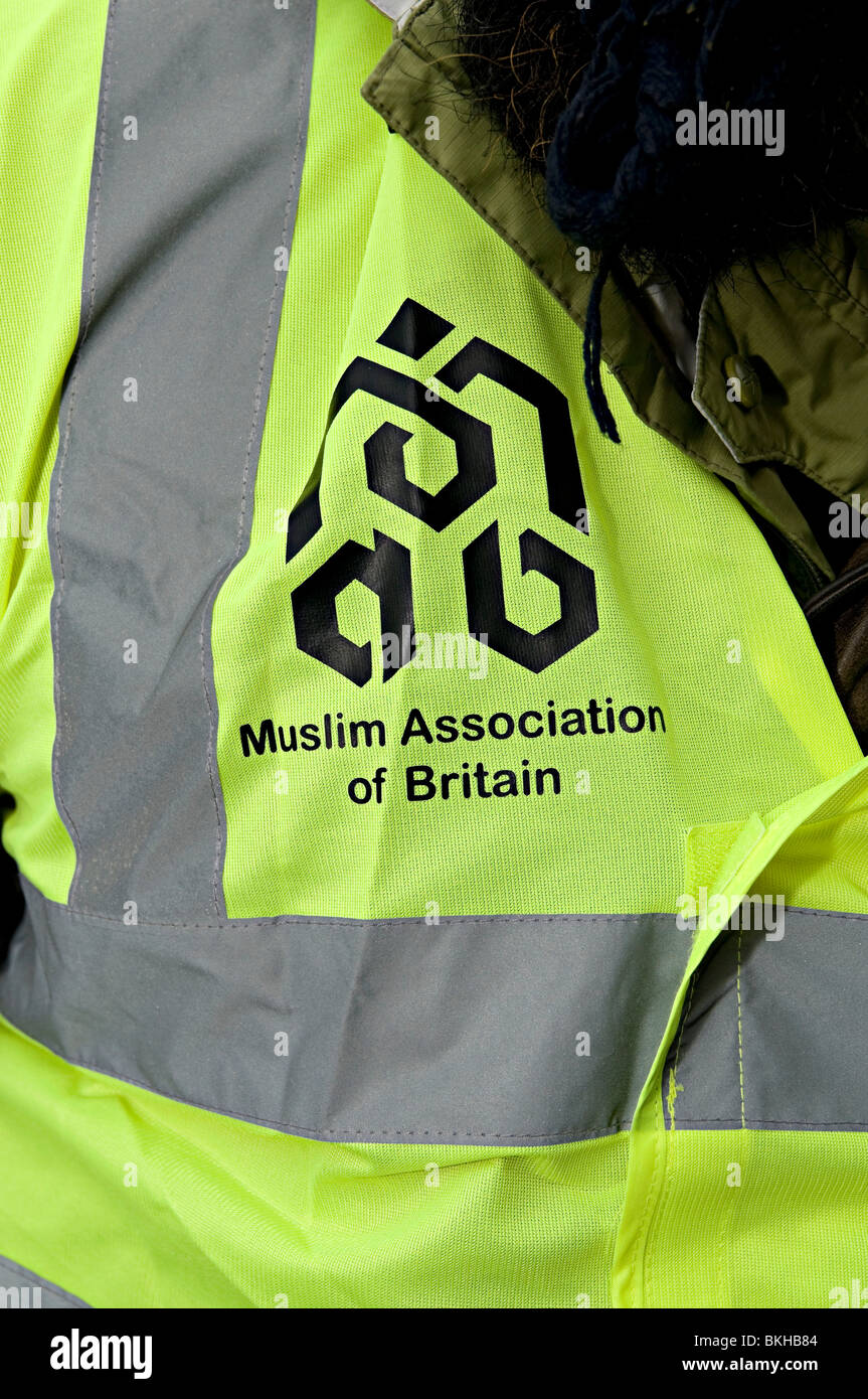Muslim association of Britain symbol on a bright tabard to help organize a march - Stock Image