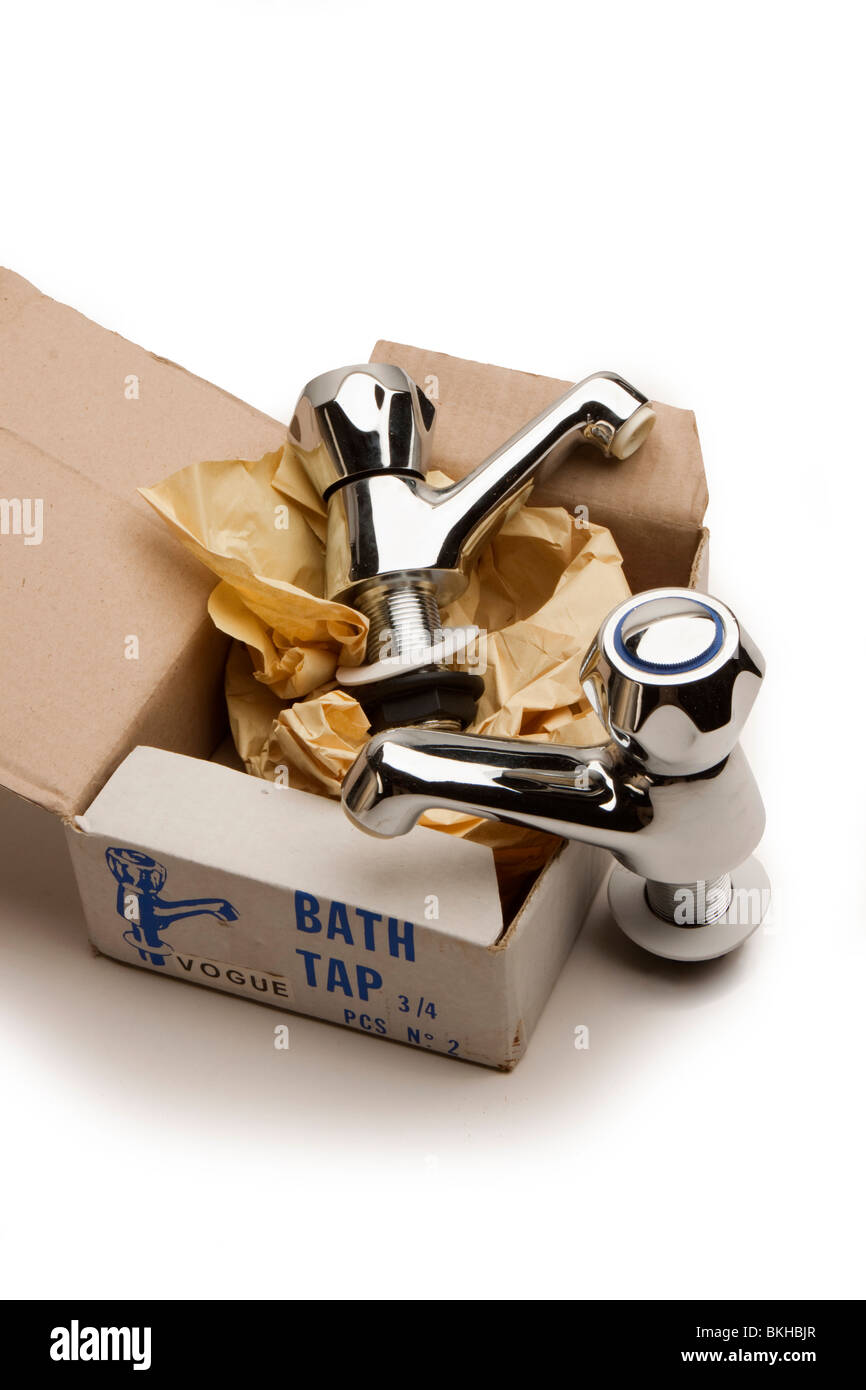 home improvements two new chrome plated bath taps unwrapped from their box - Stock Image