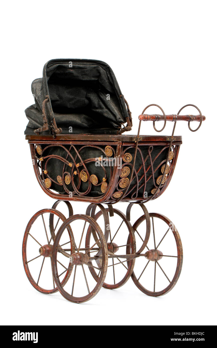 Rare antique Victorian wooden dolls pram with reversible hood, isolated on white background - Stock Image
