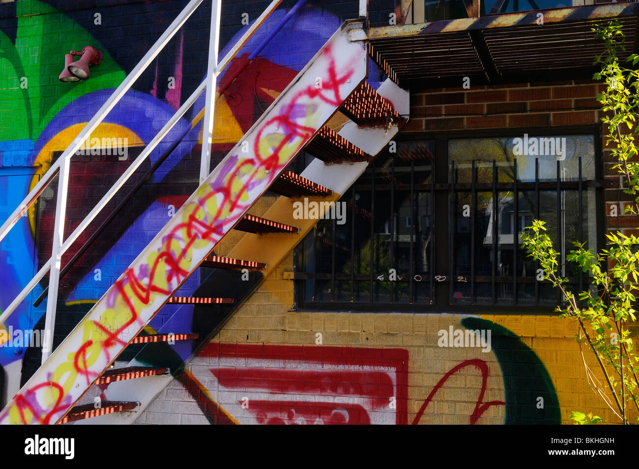 Heavily tagged staircase and graffiti on the back of a building at Keele subway station Toronto Stock Photo
