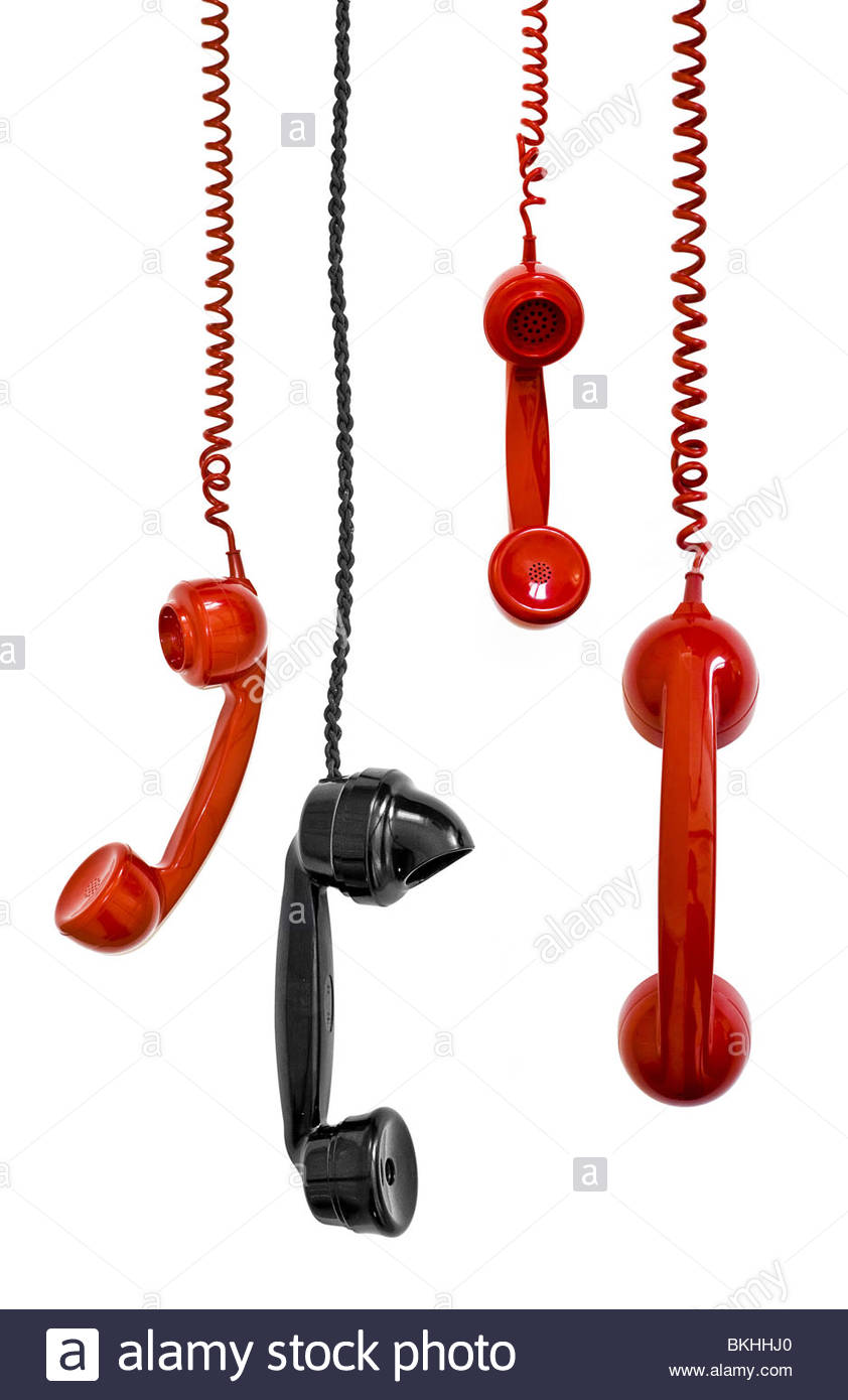 Retro telephone receivers or handsets on white background - Stock Image