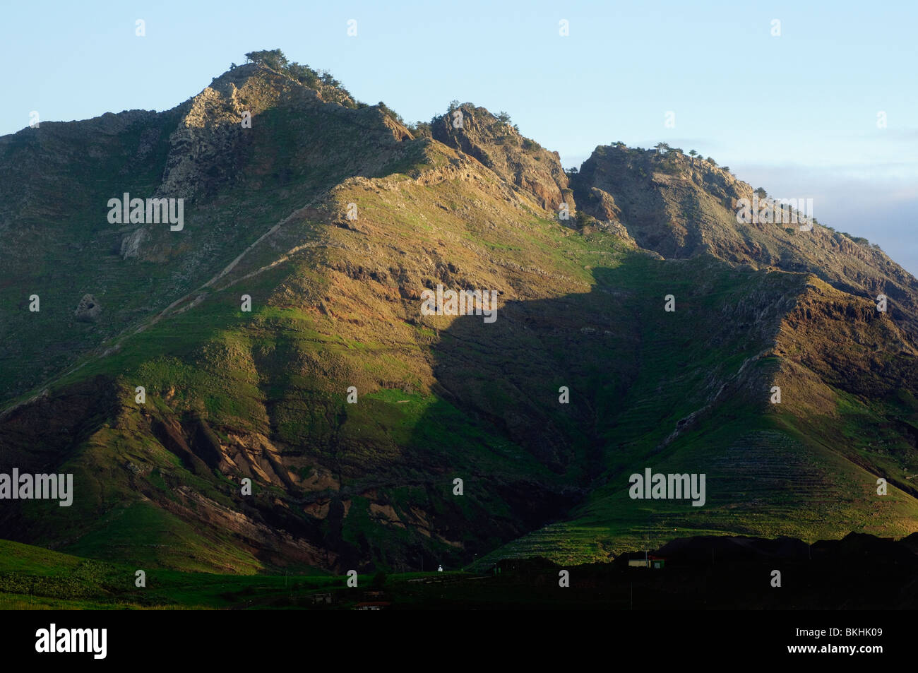 Early morning light on rugged peaks of Porto Santo, the neighbouring island to Madeira - Stock Image