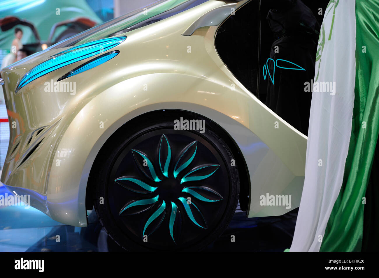 A model poses beside an IAT 'Zu' electric concept car, designed by IAT (China) Automobil Technology, at - Stock Image