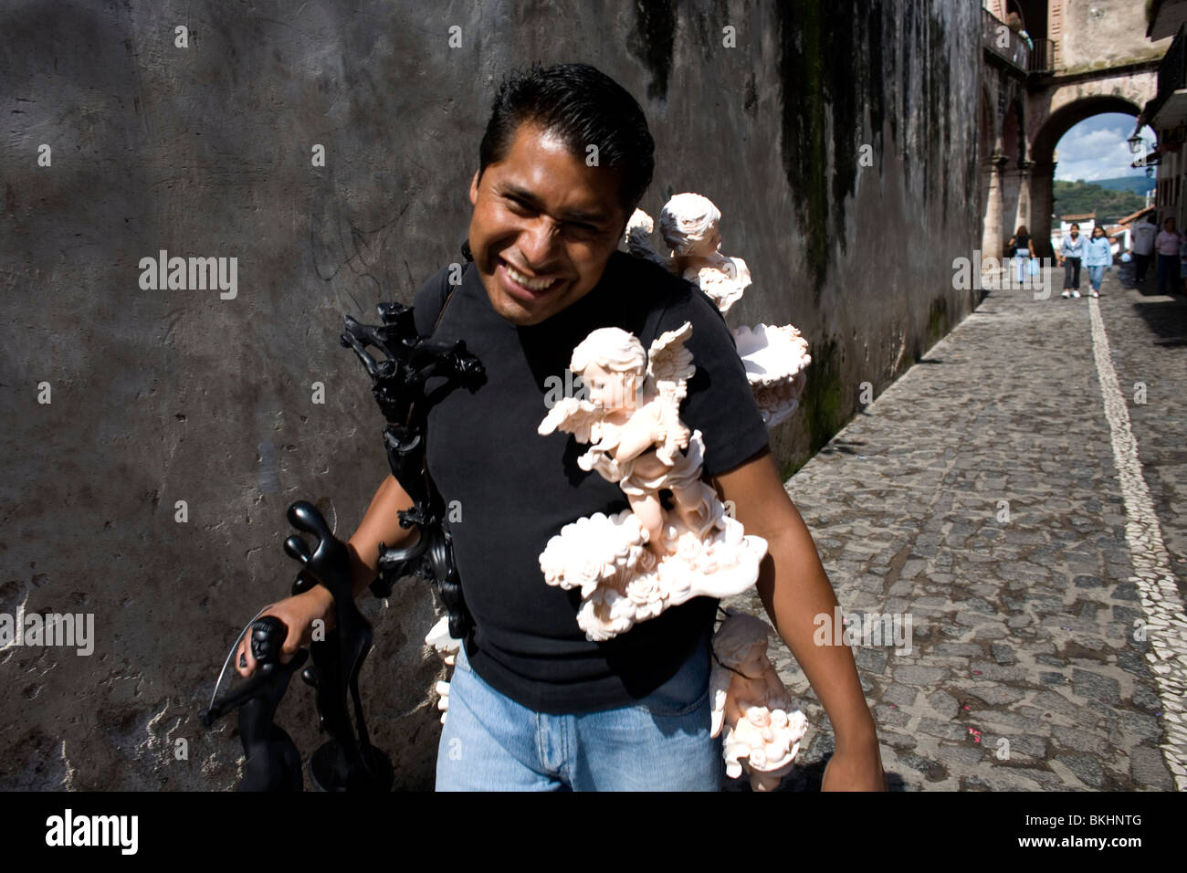 A man sells religious souvenirs to tourists in Taxco de Alarcon, Guerrero State, Mexico, August 20, 2007. Photo/Chico Stock Photo