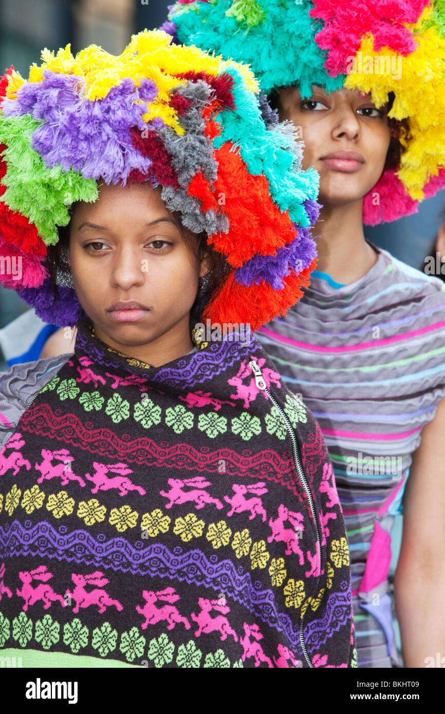 Two models wearing big hats, Alternative Fashion Week, London, Spitalfields Market - Stock Image