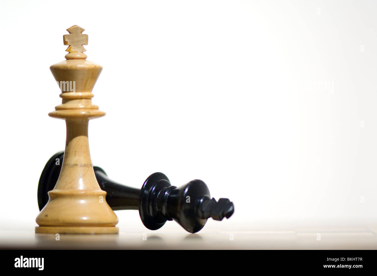 Chess. White King victorious on chess board - Stock Image