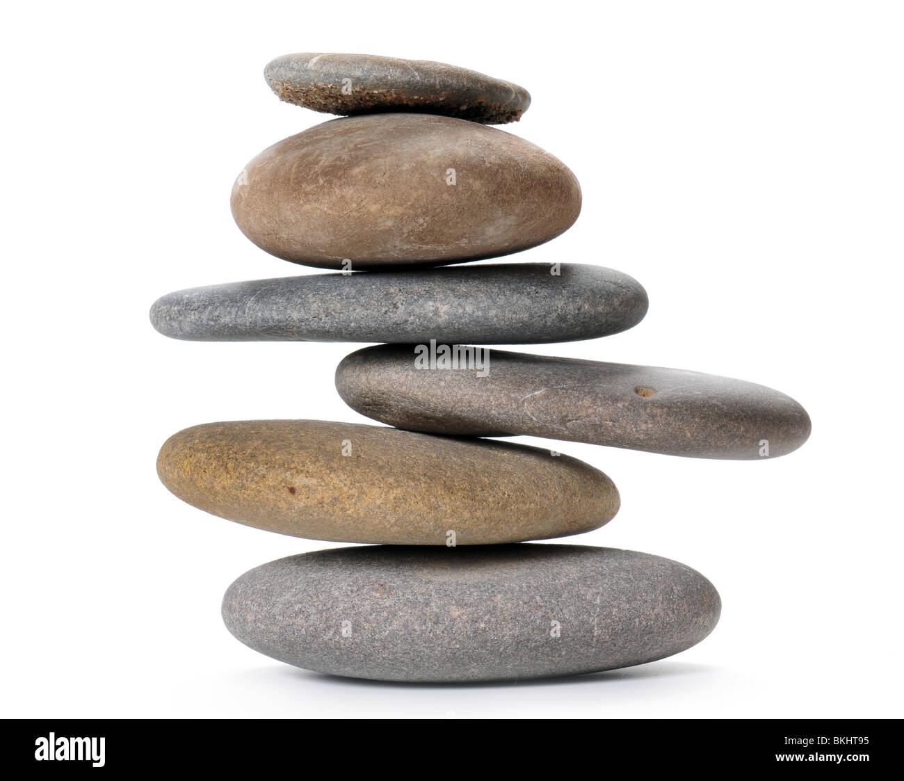 Zen like balanced stone tower isolated on white - Stock Image