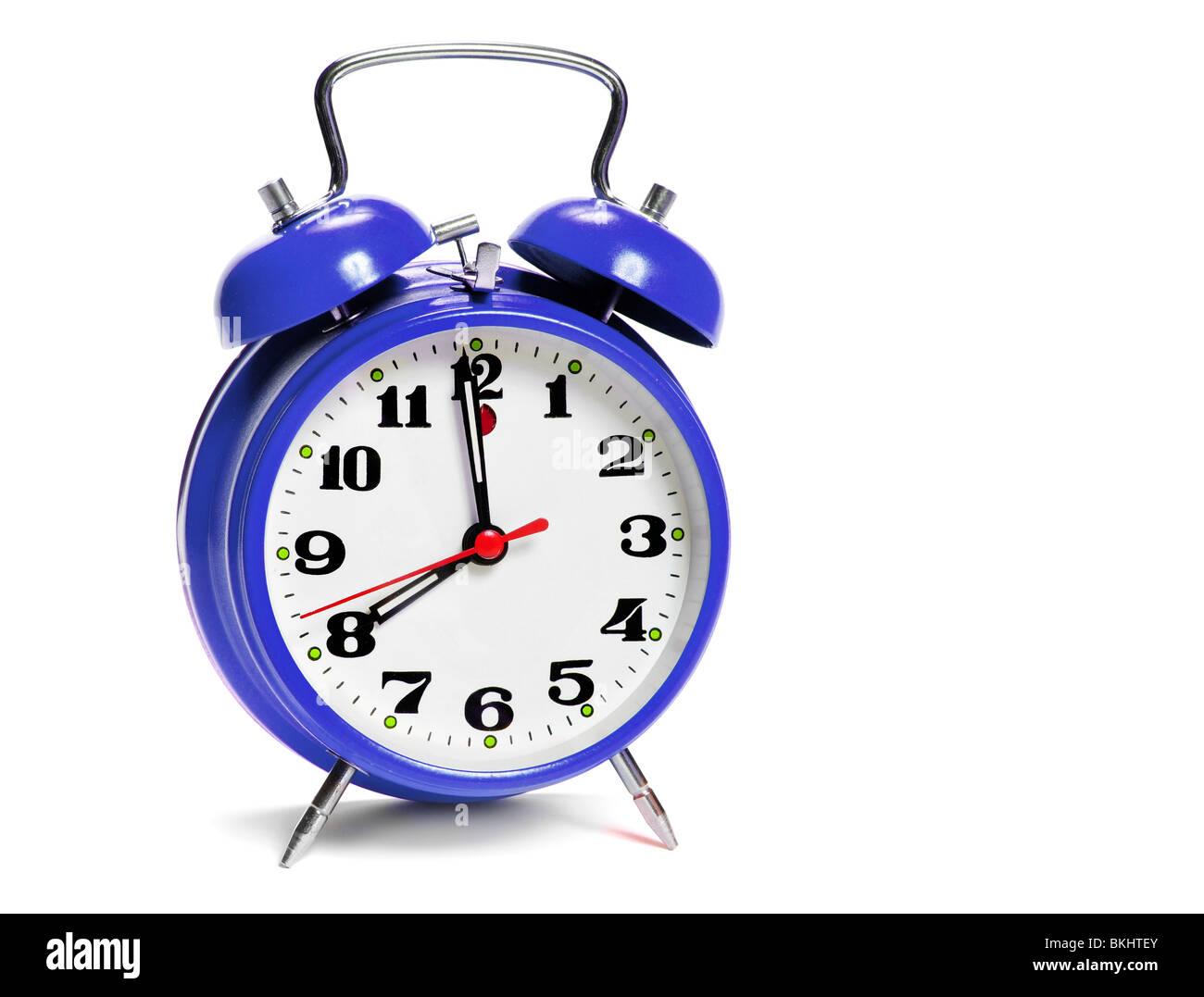 vintage alarm clock isolated on white - Stock Image