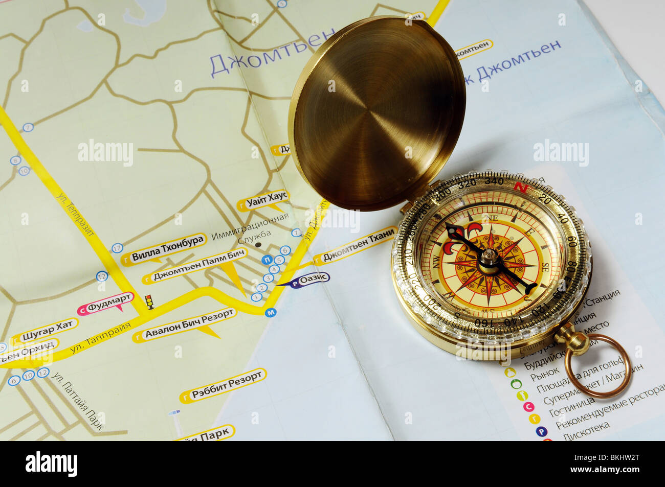 Old brass compass on tourist map of Thailand - Stock Image