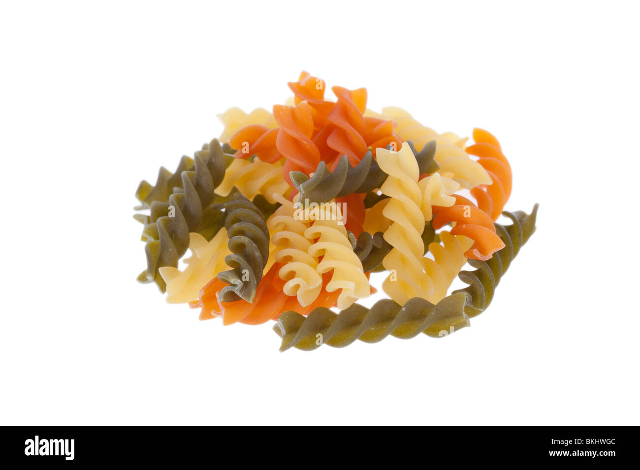 Tricolore fusilli pasta isolated on a white background - Stock Image