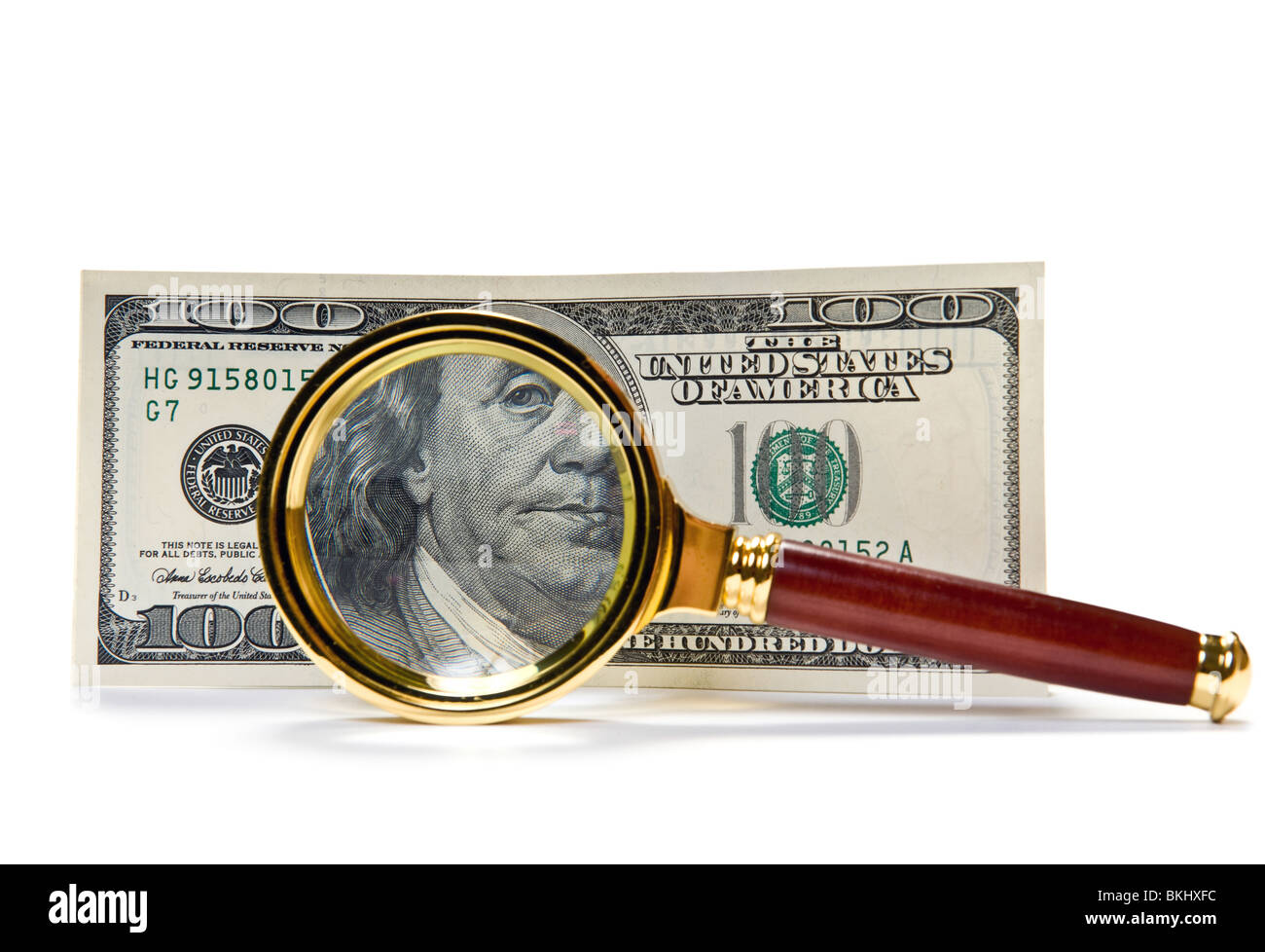 one hundred US Dollars with magnifying glass - Stock Image