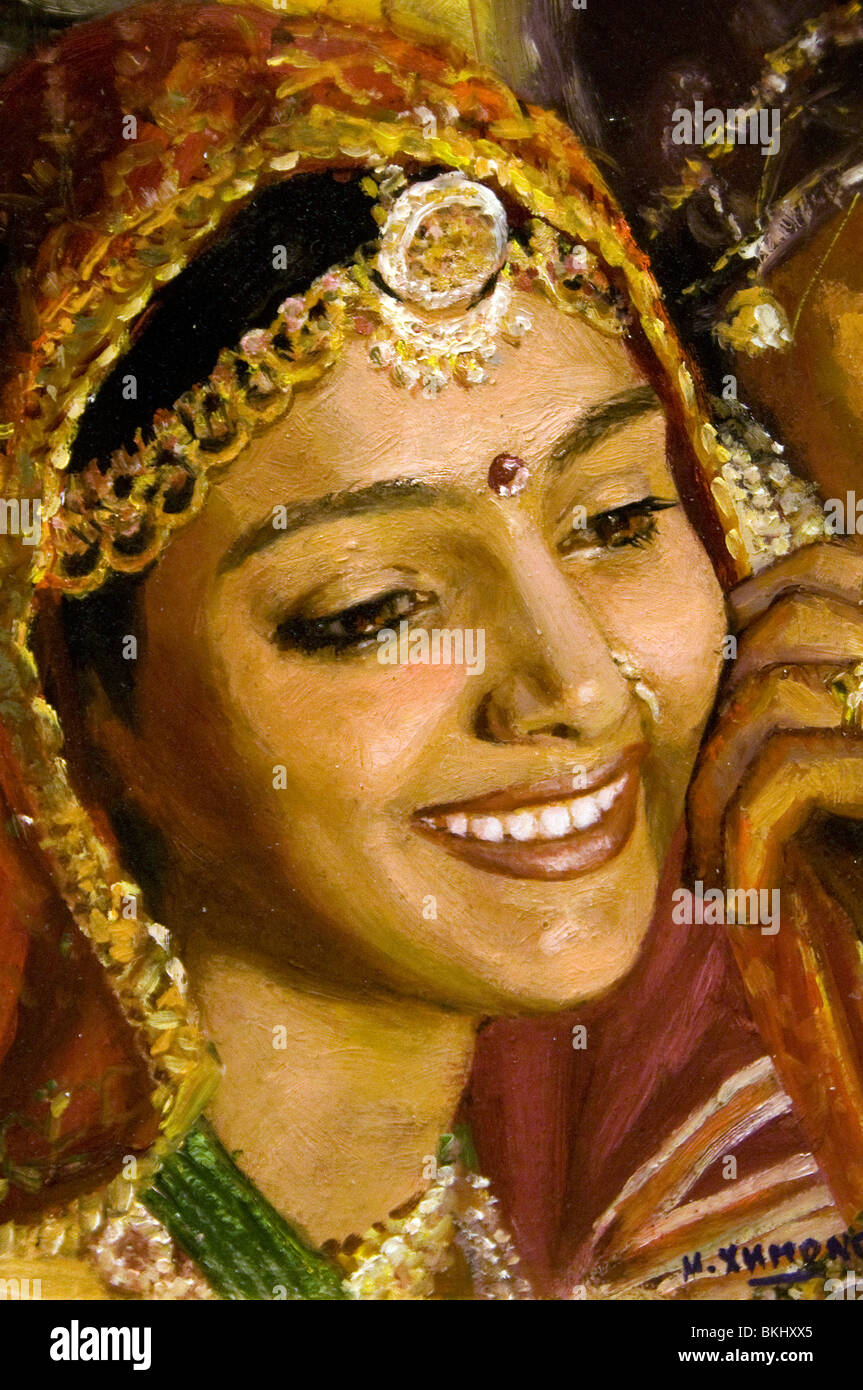 Painting Beautiful Young Woman in a sari in India Rajasthan Jaisalmer Woman Jewel Jewelled Clothes - Stock Image