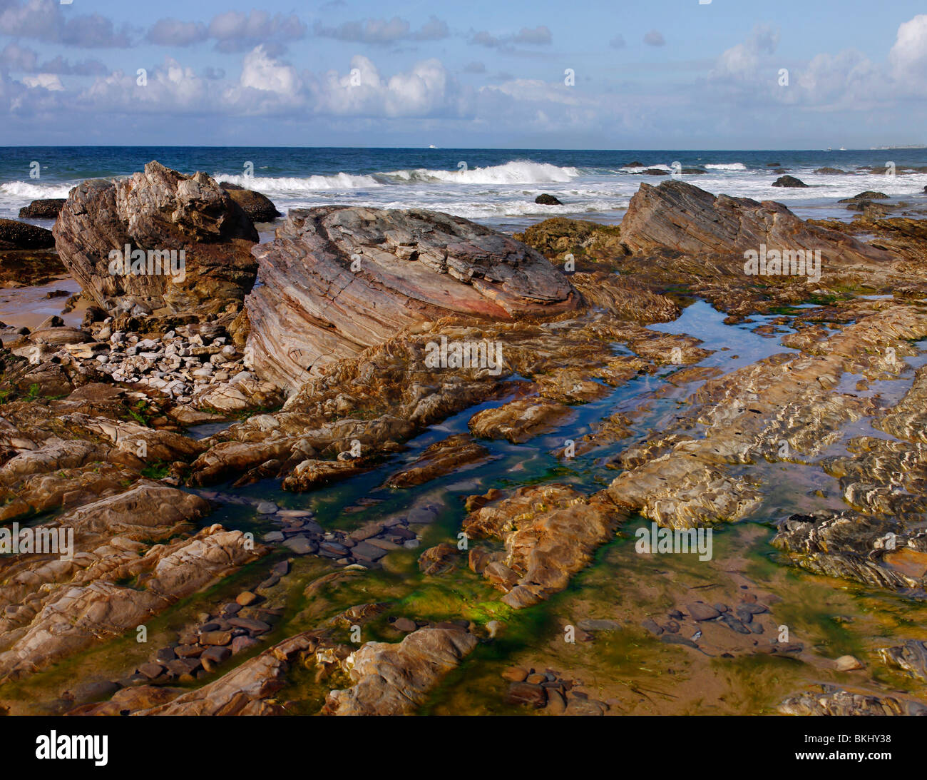 Tidepools in Crystal Cove State Park with colorful rocks formation. - Stock Image