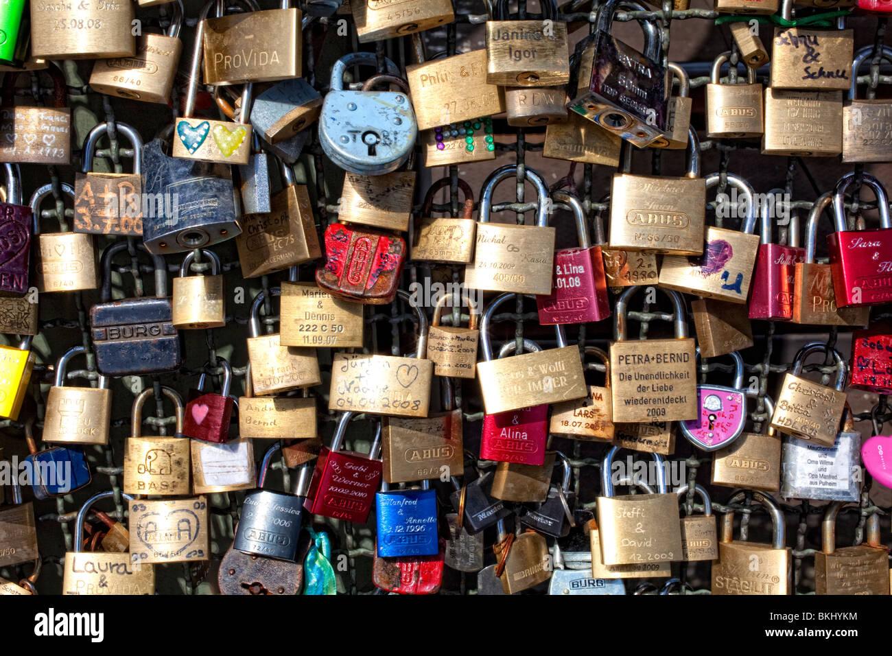 Padlocks as a symbol for friendship and love on Hohenzollernbruecke Bridge, Cologne, Germany, North Rhine-Westphalia, - Stock Image