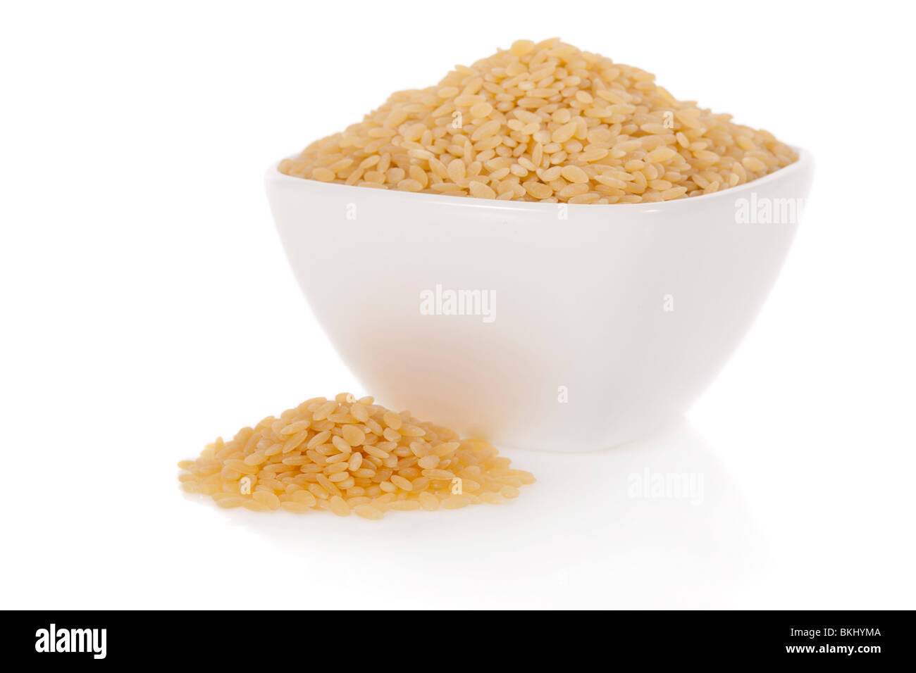 Midolline pasta used for soups in a bowl isolated on a white background - Stock Image