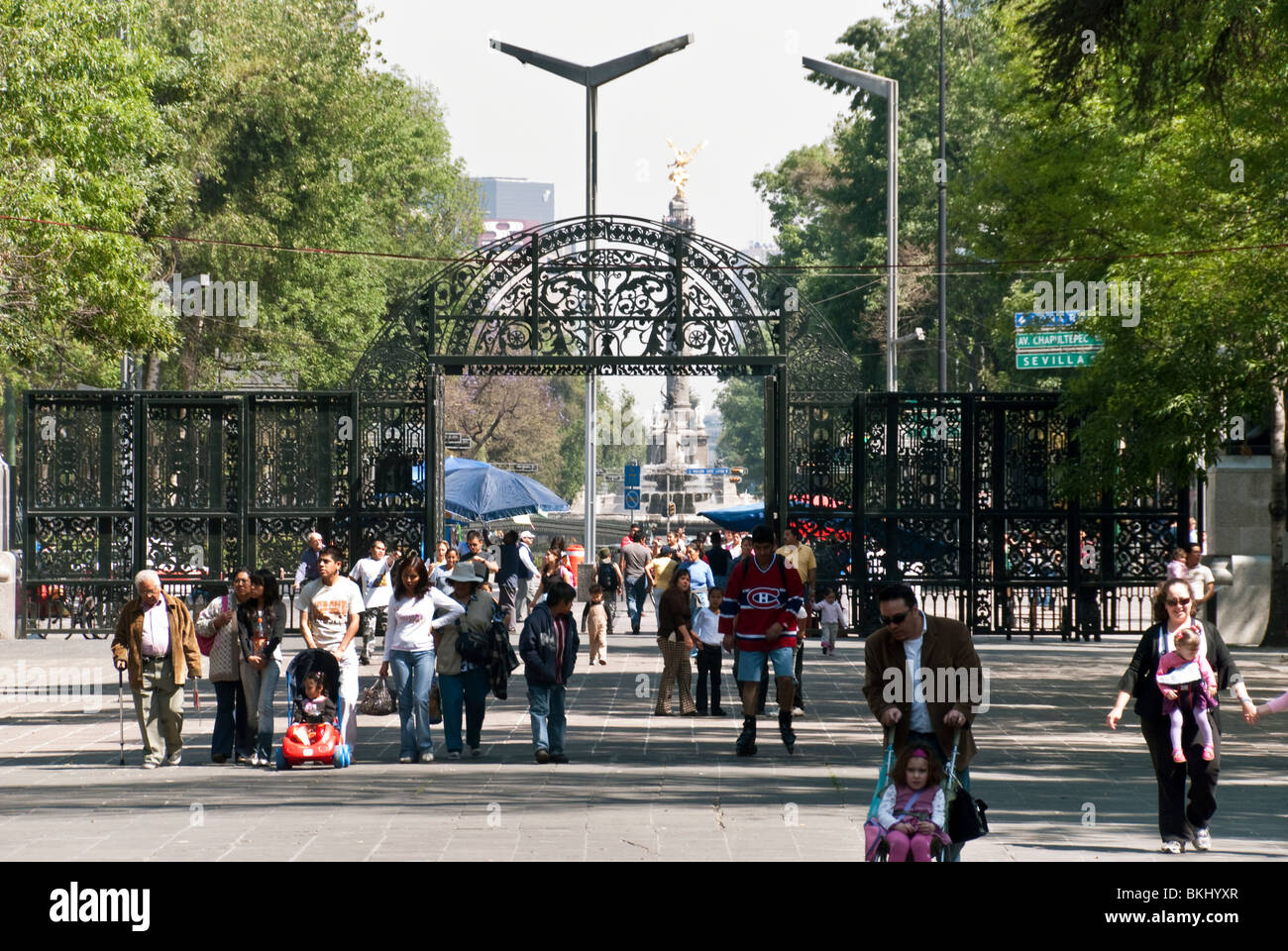 diverse multi ethnic crowd of people entering Chapultepec Park on a sunny Sunday in Mexico City - Stock Image