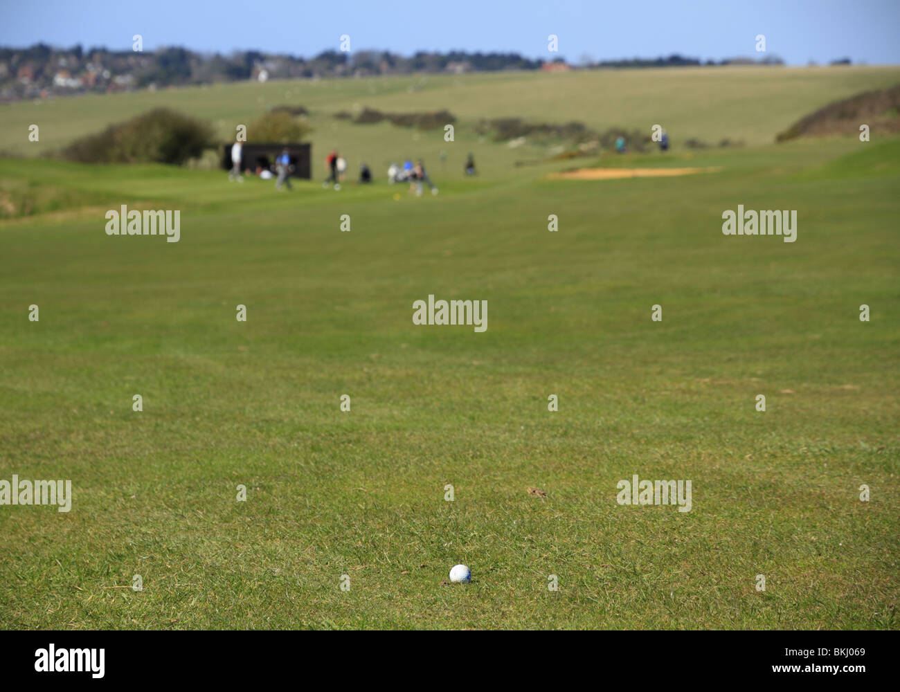 A golfers Tee Shot finds the fairway at Eastbourne Downs Golf Club, East Sussex, England - Stock Image
