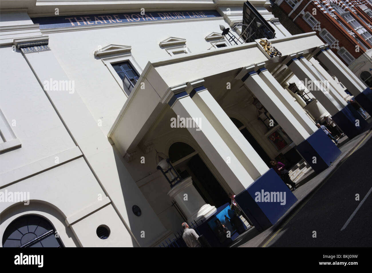 Extreme angled aspect to the main entrance to the Theatre Royal Drury Lane in London`s Covent Garden. - Stock Image
