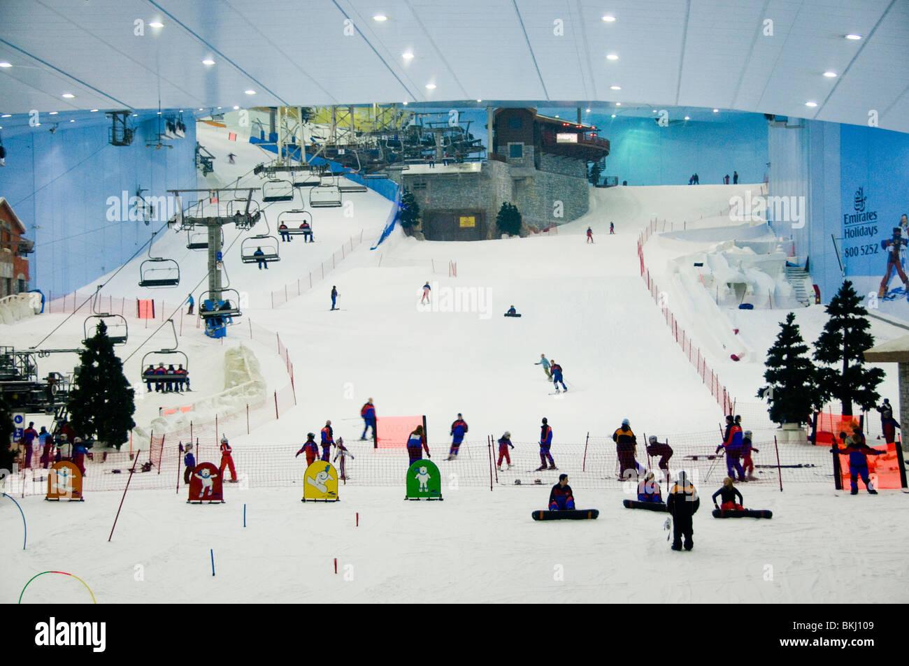 people ski-ing at ski dubai indoor ski slope in dubai stock photo