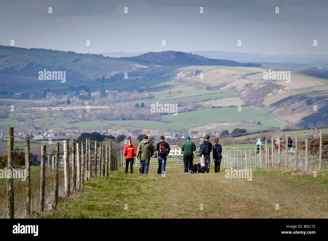 Walkers on Nine-barrow Down in the Purbeck Hills. - Stock Image