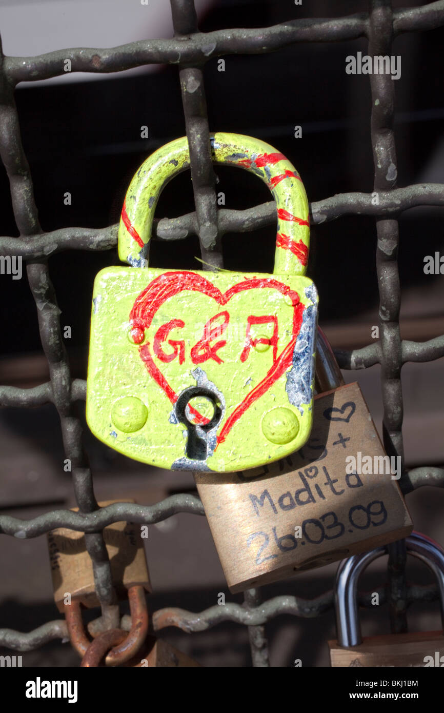 Padlocks as a symbol for friendship and love on Hohenzollernbruecke Bridge, Cologne, Germany, North Rhine-Westphalia, - Stock Image