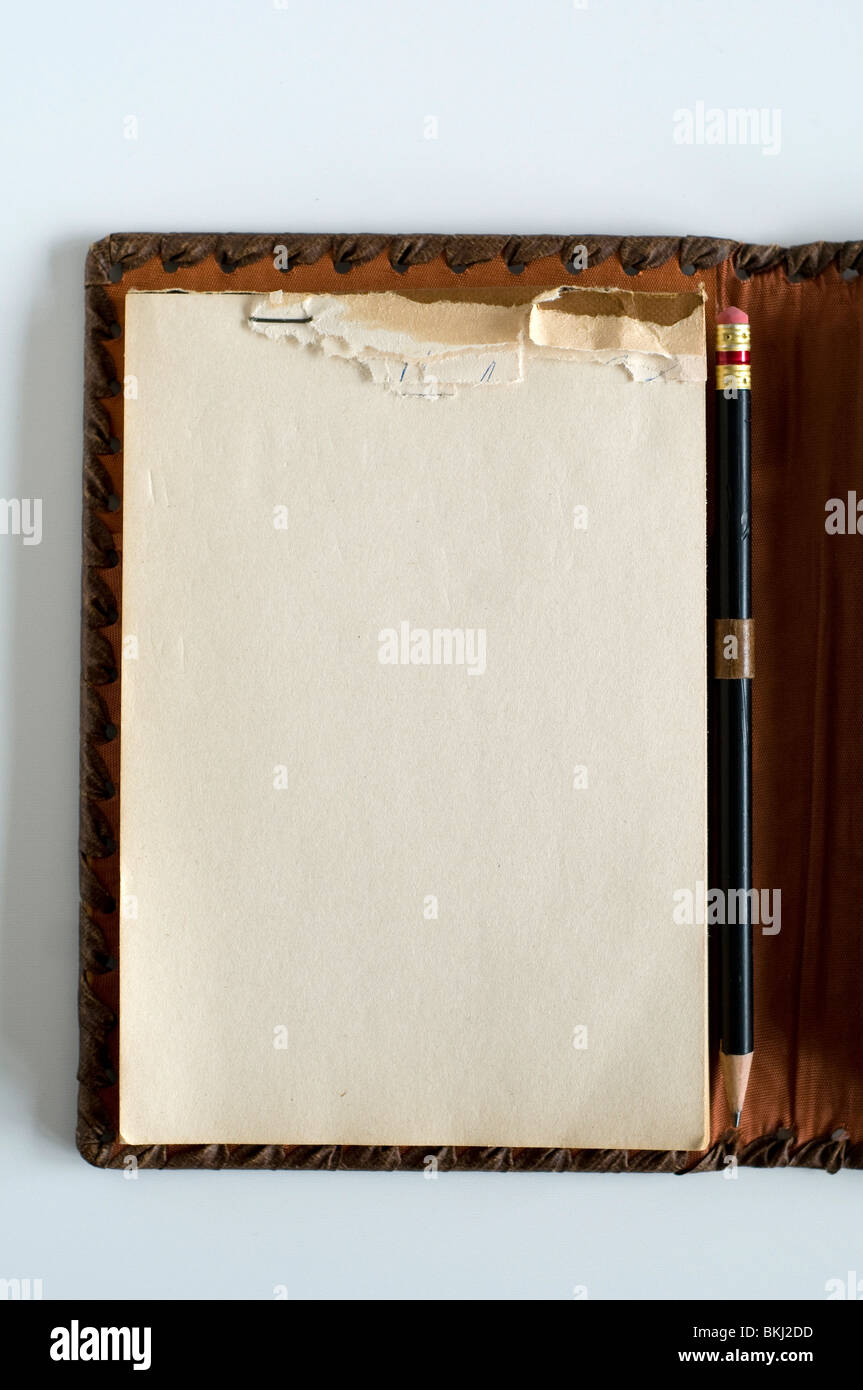 Open blank note-pad with pencil. - Stock Image