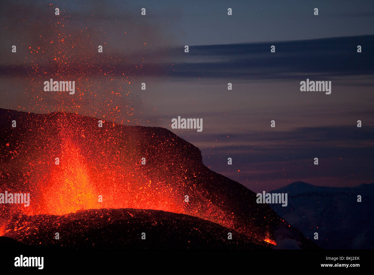 Lava fountains during start of Iceland Eyjafjallajökull volcanic eruption at dusk March 2010 - Stock Image