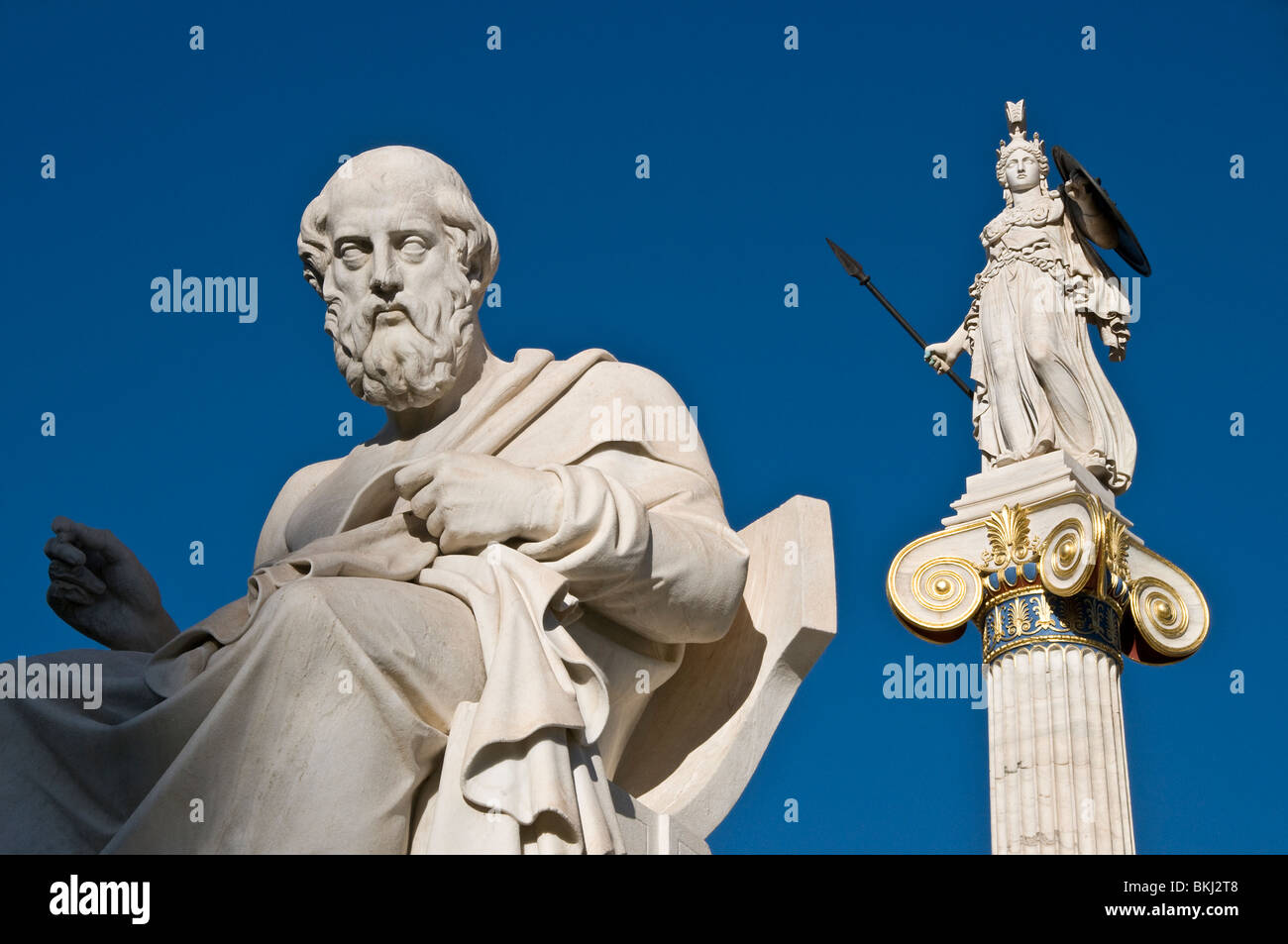 Marble statues of goddess Athena Pallas and the ancient greek philosopher Plato in front of the Academy of Athens - Stock Image
