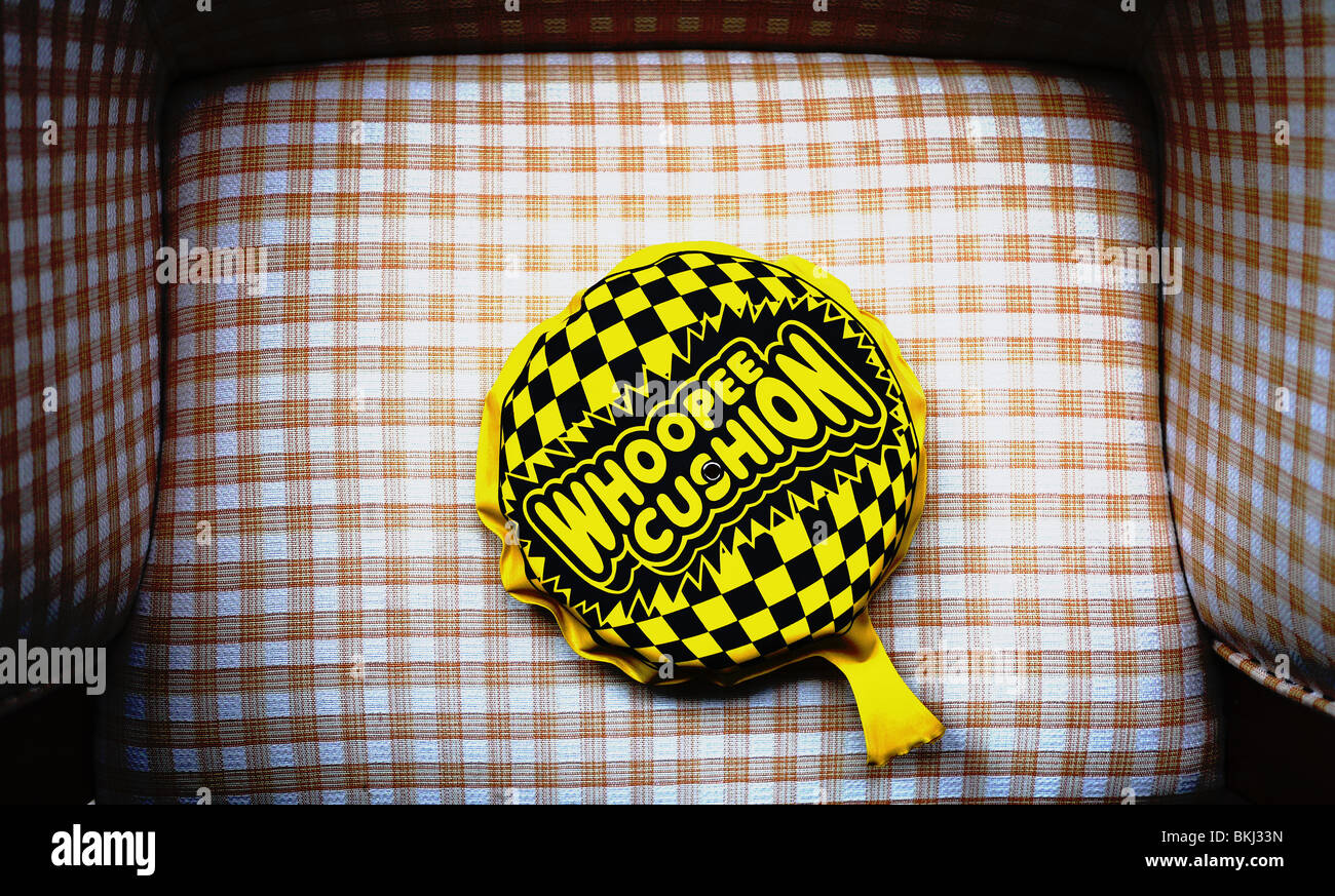 Whoopee cushion on a chair - Stock Image