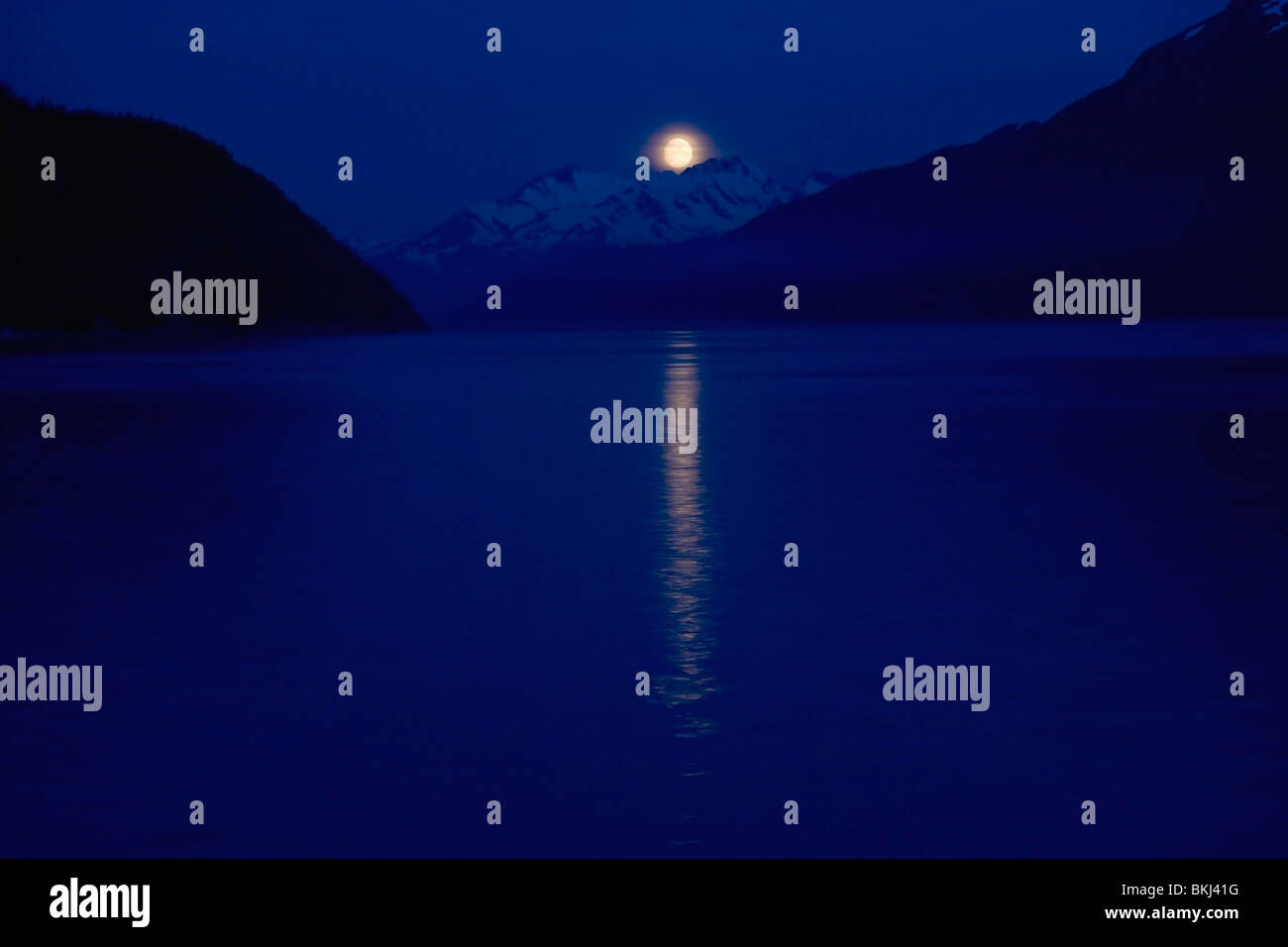 Taiya Inlet, Skagway, Alaska, United States Of America; Moon Over The Chilkat Mountains In The Lynn Canal Of The - Stock Image