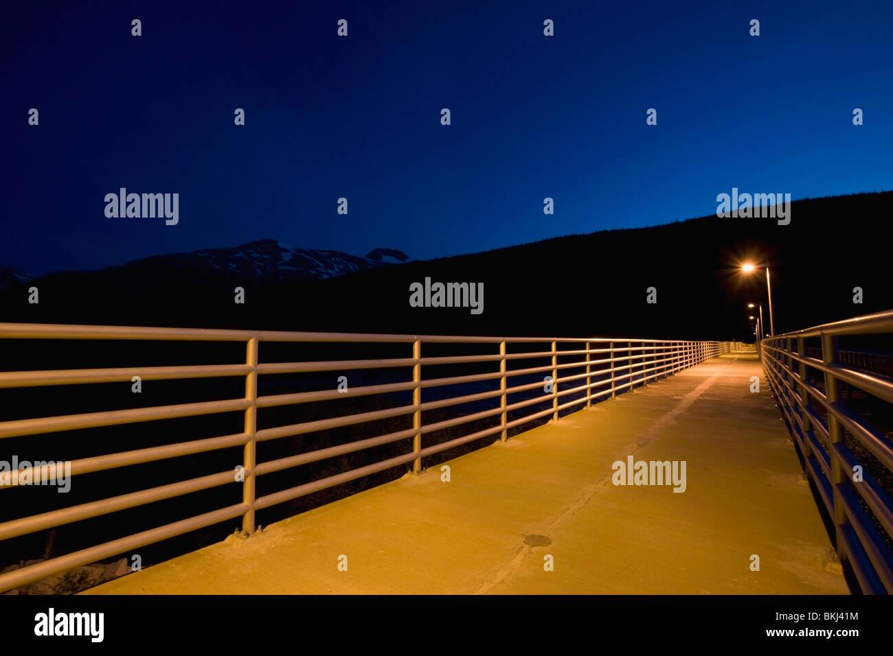 Taiya Inlet, Skagway, Alaska, United States Of America; Pat Moore Bridge Flooded With Lights At Night - Stock Image