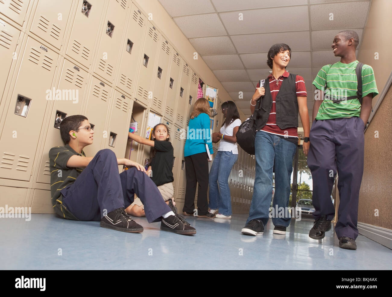 Fort Lauderdale, Florida, United States Of America; Students In The School Hallway - Stock Image