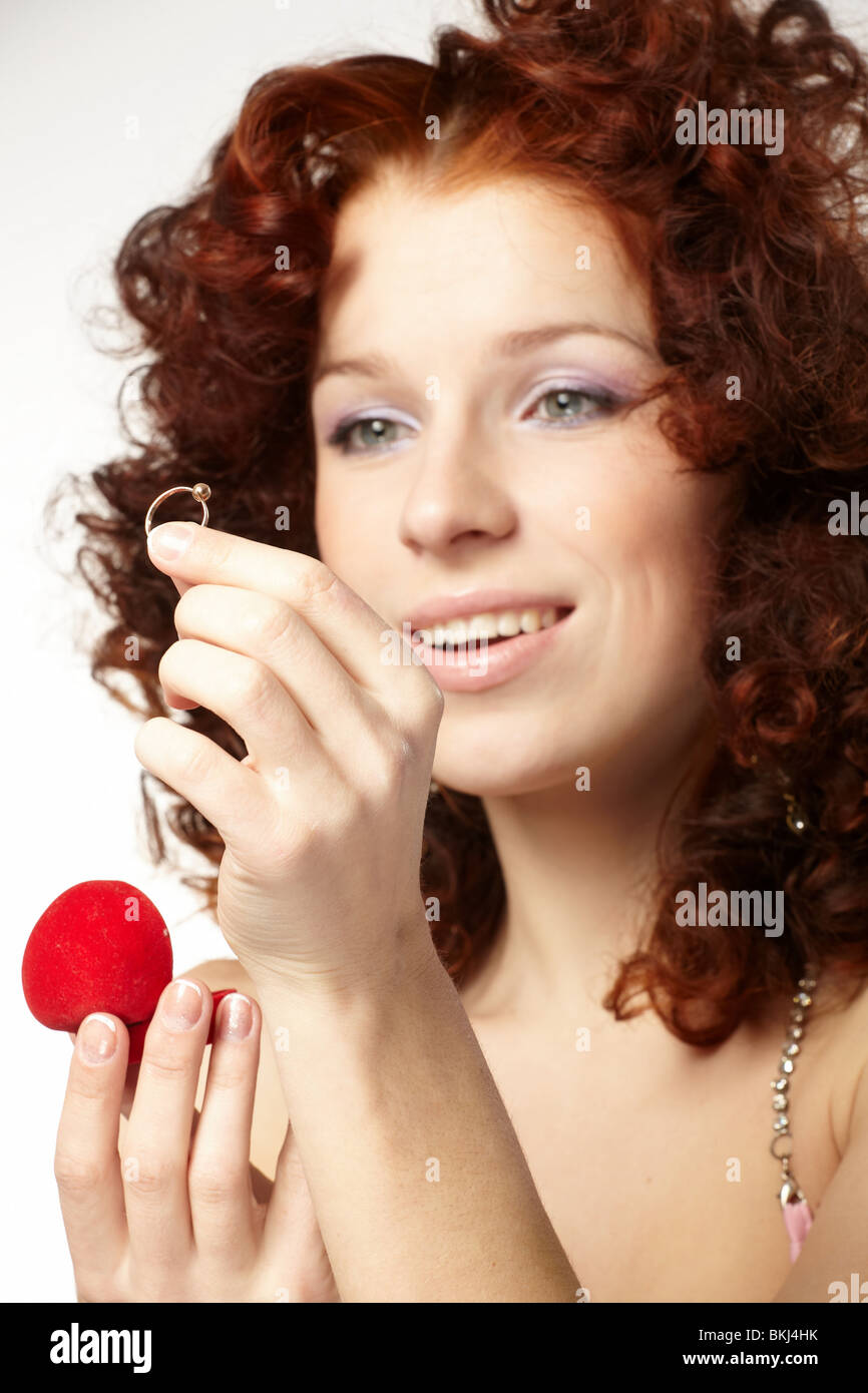 Beautiful woman with red gift box with jewel - Stock Image